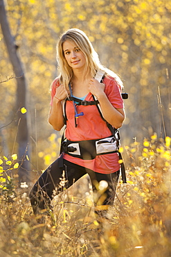 USA, Utah, portrait of young woman hiking in forest