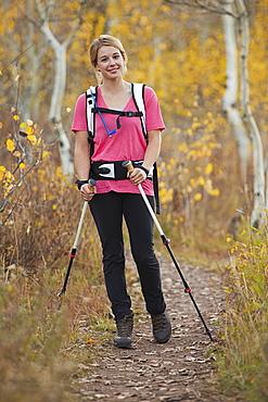 USA, Utah, young woman walking on trail