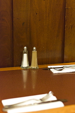 Salt and pepper condiments on cafe table