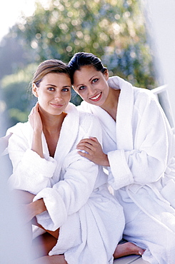 Two woman wearing bath robes