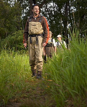 Fly Fisherman walking on path