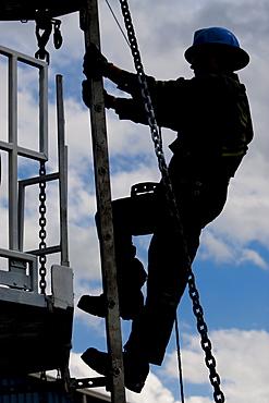 Worker climbing