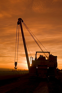 Heavy equipment at sunset