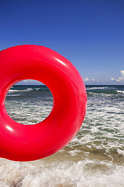 Red Inner tube at beach, Isabel Beach, Puerto Rico