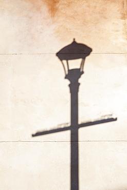Shadow of street lamp on wall, Portland, Oregon