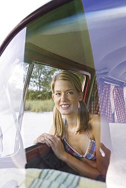 Woman sitting in passenger seat of van