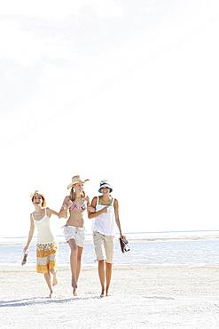 Young women walking on beach