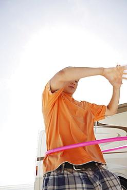 Young man hula hooping