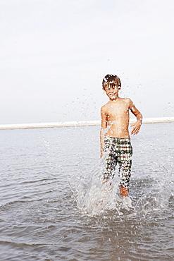 Boy splashing in ocean
