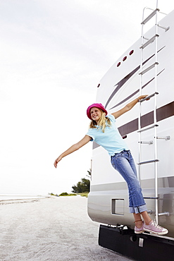 Girl climbing on motor home ladder