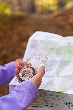 USA, New Jersey, Close-up of woman's hands holding compass and map