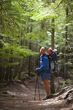 Woman with son (4-5) on trail of cedars, Trail of the Cedars, Glacier National Park, Montana, USA