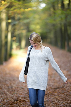 Portrait of smiling woman in autumn forest