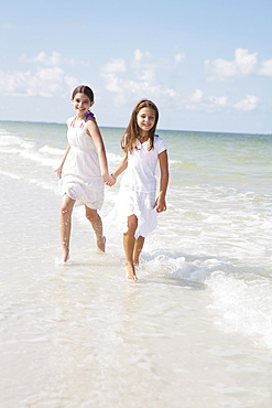 Girls running in ocean