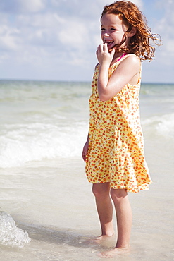 Girl wading in ocean