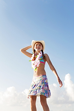 Girl in bathing suit with lei around neck