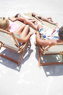 Family sunbathing on beach