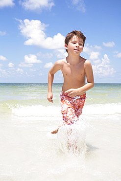 Boy running in ocean
