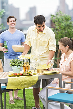Friends enjoying barbecue in garden