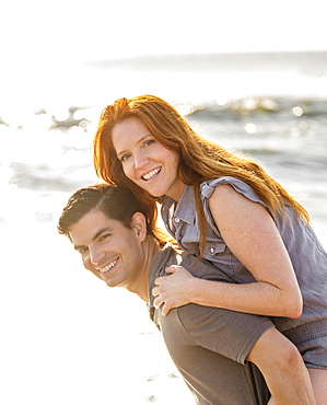Portrait of couple on beach, Palm Beach, Florida