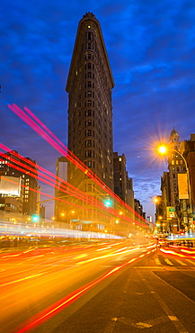Traffic at night, Flatiron building in background, New York City, New York