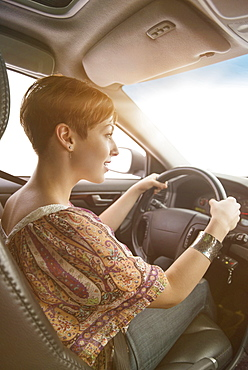 Side view of woman driving car