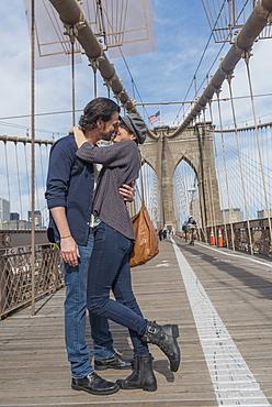 Happy couple kissing on Brooklyn Bridge, Brooklyn, New York