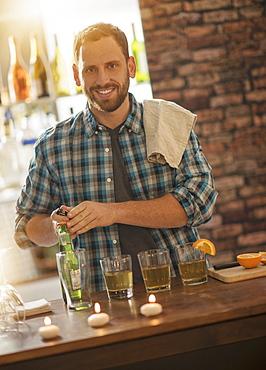 Portrait of smiling bartender