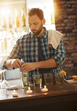 Bartender opening bottle