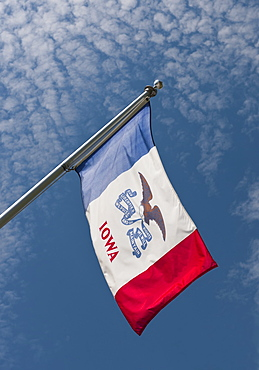 USA, Iowa State flag against sky