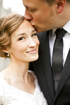 Newly wed couple kissing