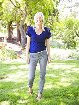 Portrait of blonde woman in park, USA, Utah, Salt Lake City