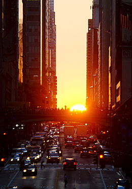 USA, New York, New York City, Sunset illuminating busy street