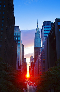 USA, New York, New York City, Chrysler Building and street at sunset
