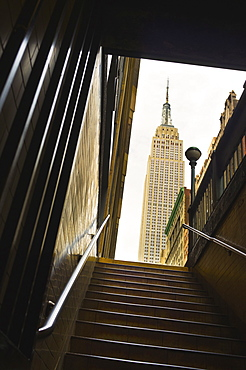 Empire State Building as seen from subway station staircase
