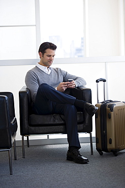 Businessman sitting in airport lounge