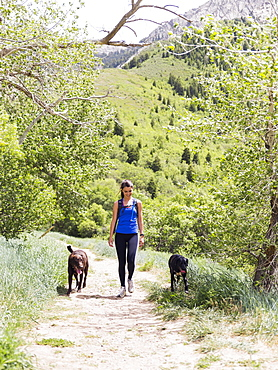 Woman with two dogs hiking in landscape, USA, Utah, Salt Lake City