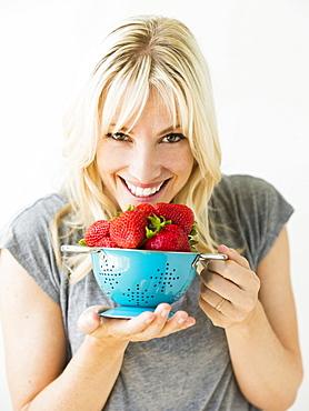 Woman holding fresh strawberries