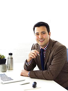 Portrait of businessman sitting in office