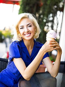 Woman posing with ice-cream, Costa Mesa, California