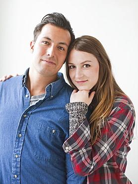Studio Shot portrait of young couple