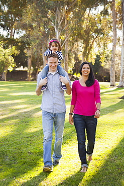 Portrait of happy family in park, Irvine, California