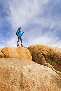 USA, California, Joshua Tree National Park, Female hiker on rocks, USA, California, Joshua Tree National Park