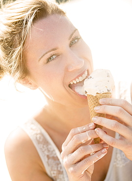 Woman eating ice cream, USA, New Jersey, Jersey City