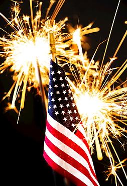 Sparkler and American flag an black background