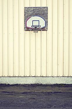 Basketball hoop on side of building in industrial area, Portland, Oregon