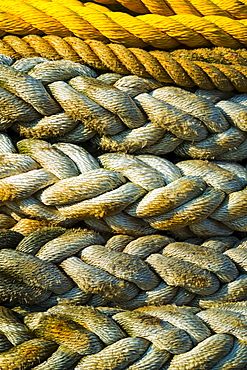 Braided ropes in harbor, close-up