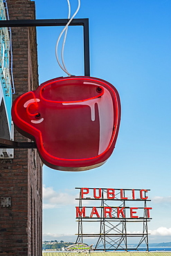 Neon coffee cup in front of cafe, low angle view, Seattle, Washington