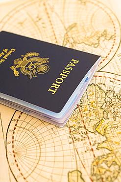 Passport sitting on antique map
