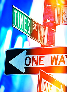 Directional signs at night, New York City, New York